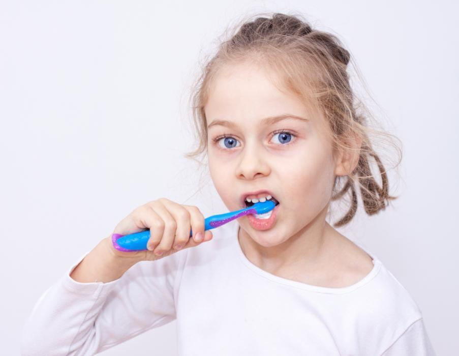 a girl brushes her teeth | children's dentist pascoe vale