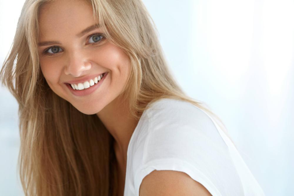 a woman smiles | pascoe vale invisalign