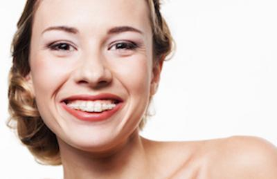 Woman smiling with braces on teeth | Pascoe Vale Dentist