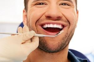 Man smiling in dental chair | dentist pascoe vale vic