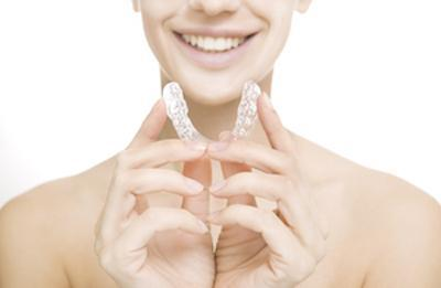 Woman holding mouth guard | glenroy vic dentist