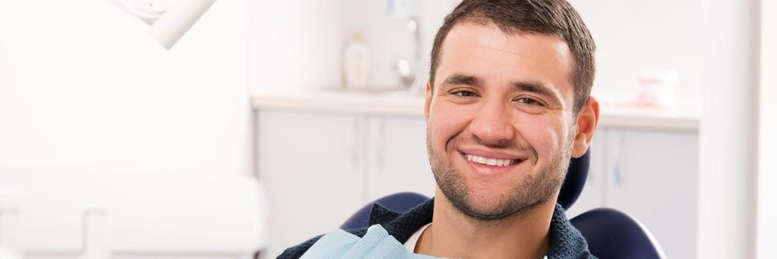 man smiling in dental chair | Dentist glenroy vic
