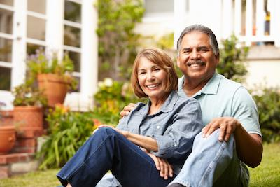 Couple smiling in backyard | Dentist Pascoe Vale VIC