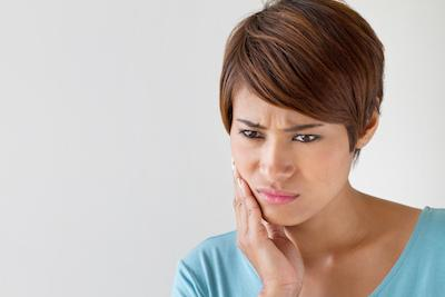 Woman holding jaw with toothache | dentist pascoe vale vic